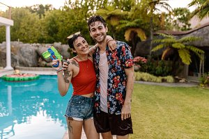 Cheerful couple by the pool