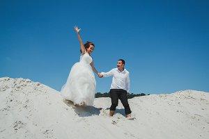 Wedding couple is running
