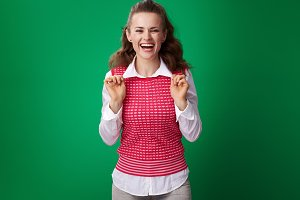 smiling young student woman isolated on green background