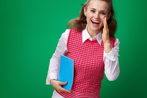 smiling student woman with blue notebook telling something