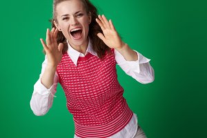 smiling student woman shouting through megaphone shaped hands