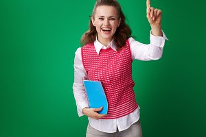smiling student woman with blue notebook pulling hand to answer