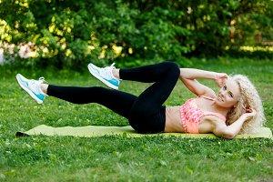 Image of athlete woman exercising on rug