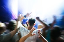 People with hands up on a concert