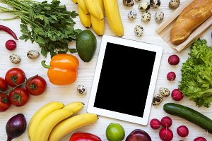 Set of raw healthy food with tablet
