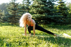 Picture of athlete blonde exercising on rug