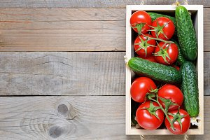 Cucumbers and tomatoes in box