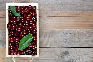 Cherry in box on wooden table