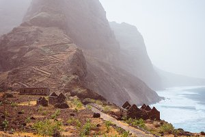 Aranhas mountain peak in the valley with house ruins and stony hiking path going up the mountain from Ponta do Sol to Cruzinha village. Santo Antao Island, Cape Verde