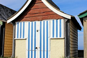Old Beach Hut with Blue Strips