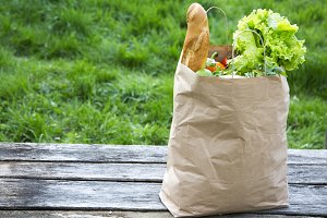 Different healthy food in paper bag