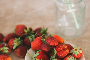 Preparing a smoothie of strawberries