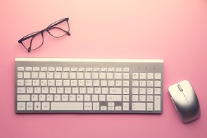 computer keyboard on pink background