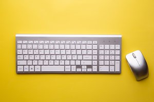 computer keyboard on yellow backgrou