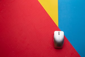 computer mouse in colorful backgroun