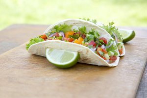 Mexican pork tacos on wooden rustic