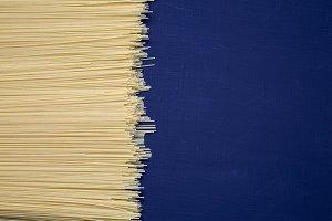Spaghetti on dark background. Textur