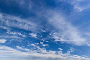 Spindrift clouds on blue sky