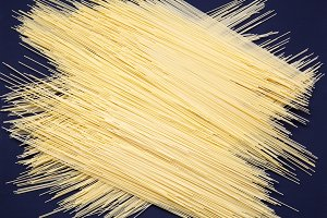 Spaghetti on dark background.Texture