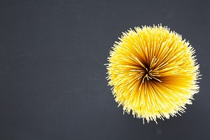 Spaghetti on dark background with