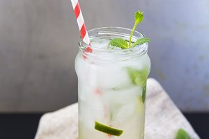 Mojito cocktail with lime, ice