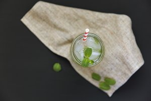 Glass of mojito with lime, ice