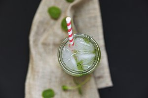 Summer drink with ice, lime and mint