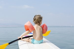child and a paddle board