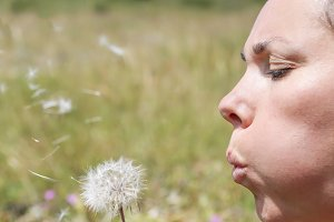 woman and a dandelion