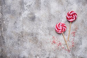 Pink lollipop on light background