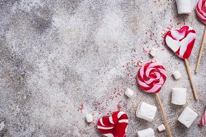 Pink lollipop, candy cane and marshmallow