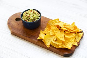 Full bowl of guacamole with nachos