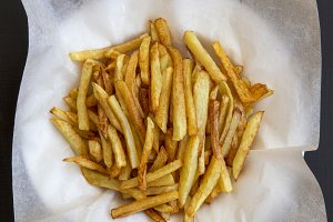 Plate of french fries, top view