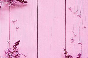 Pink wooden background with lilac