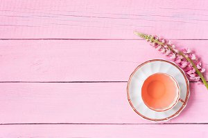 Pink background with cup of tea