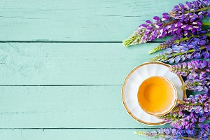 Background with tea and flowers