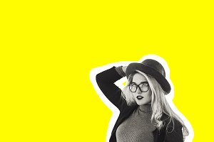 the girl in the hat. stylish girl in black and white with a hat and glasses. yellow background