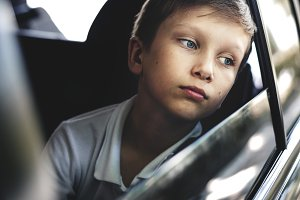 Boy looking out the car window
