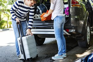 Could loading luggage into a car