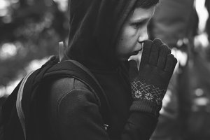 Boy lost and cold in a forest