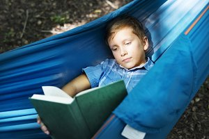 Boy reading in the hammock