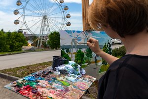 Woman paint summer park