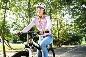 Woman enjoying bicycle ride in park