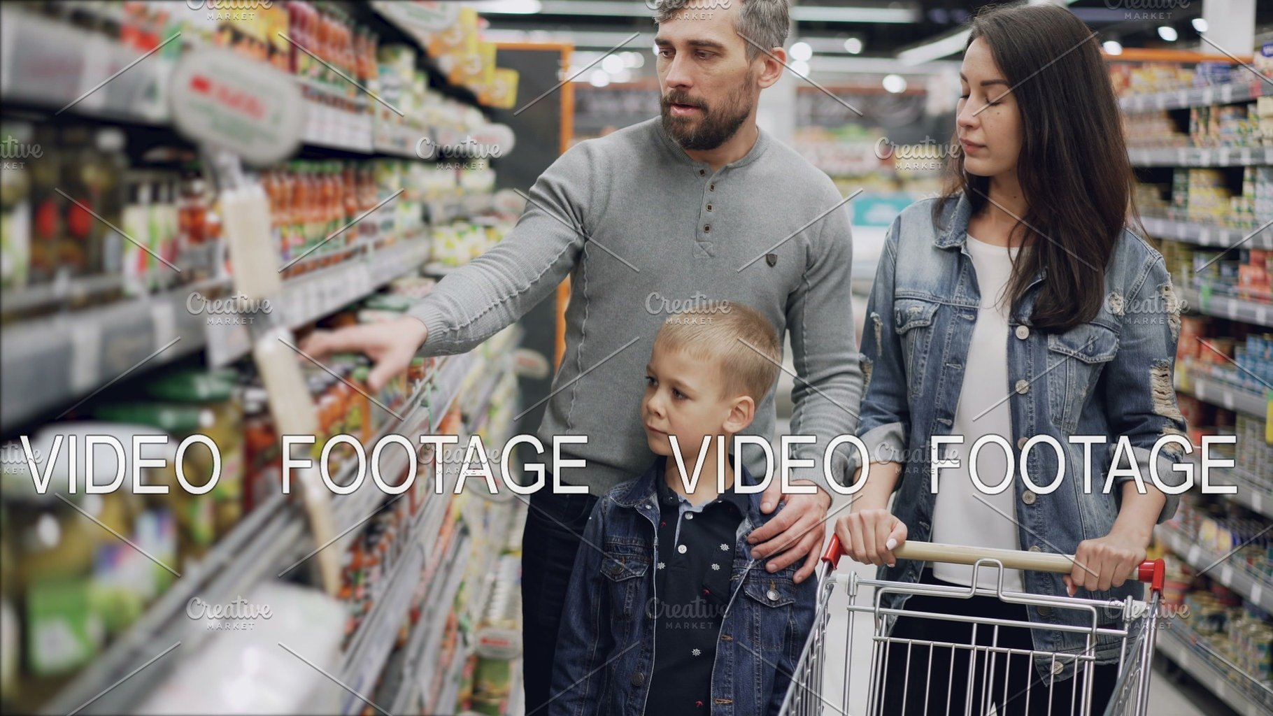 Married Couple With Cute Little Son Are Shopping For Food They Are Taking Glass Can From Shelf And Checking Ingredients And Expiry Date And Talking