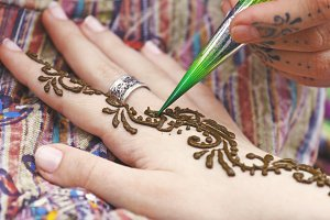 Henna tattoo on womans hand