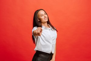 The happy business woman point you and want you, half length closeup portrait on red background.