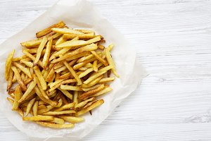 French fries on white wooden
