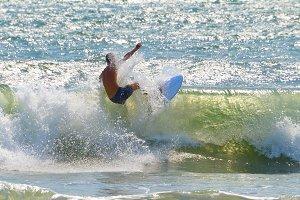 Surfer surf a wave