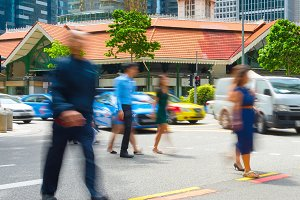 People crossing a road in Singapore