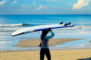woman with surfboard  beach Bali